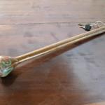 これ、ムパタのルームキー。30cmはある木の棒は、マサイ族伝統の武器を模したもの。
